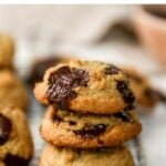 Stack of three almond flour chocolate chip cookies.