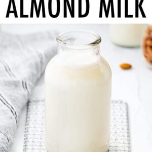 Glass bottle of homemade almond milk.