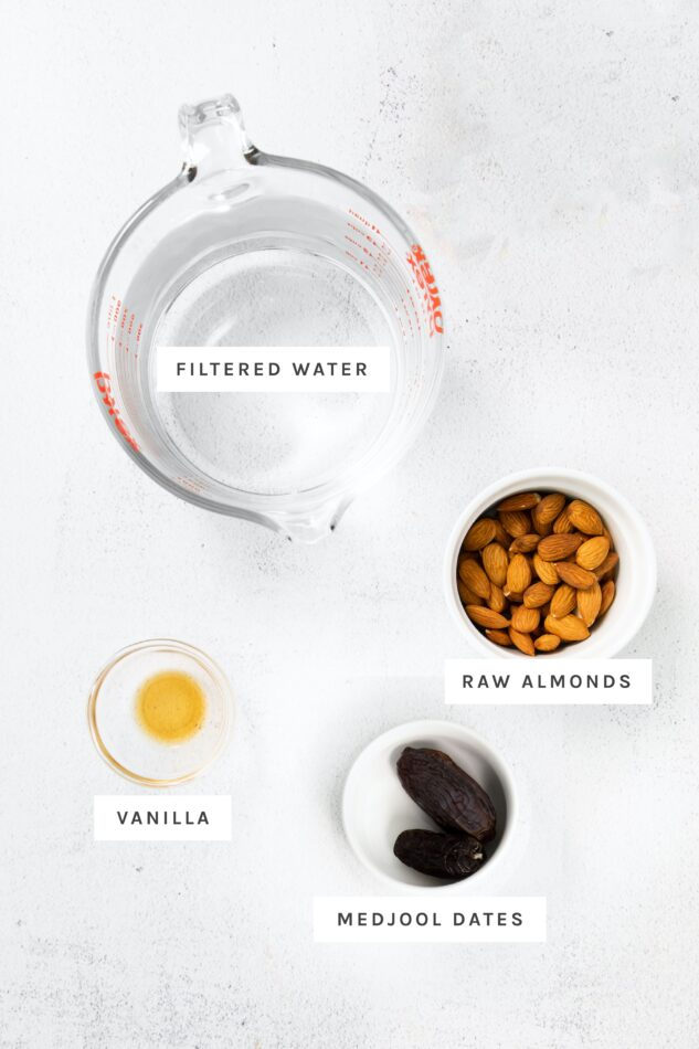 Water, almonds, vanilla and medjool dates measured out to make almond milk.