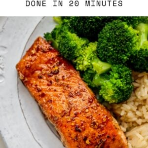 Plate with a piece of balsamic salmon, brown rice and broccoli.