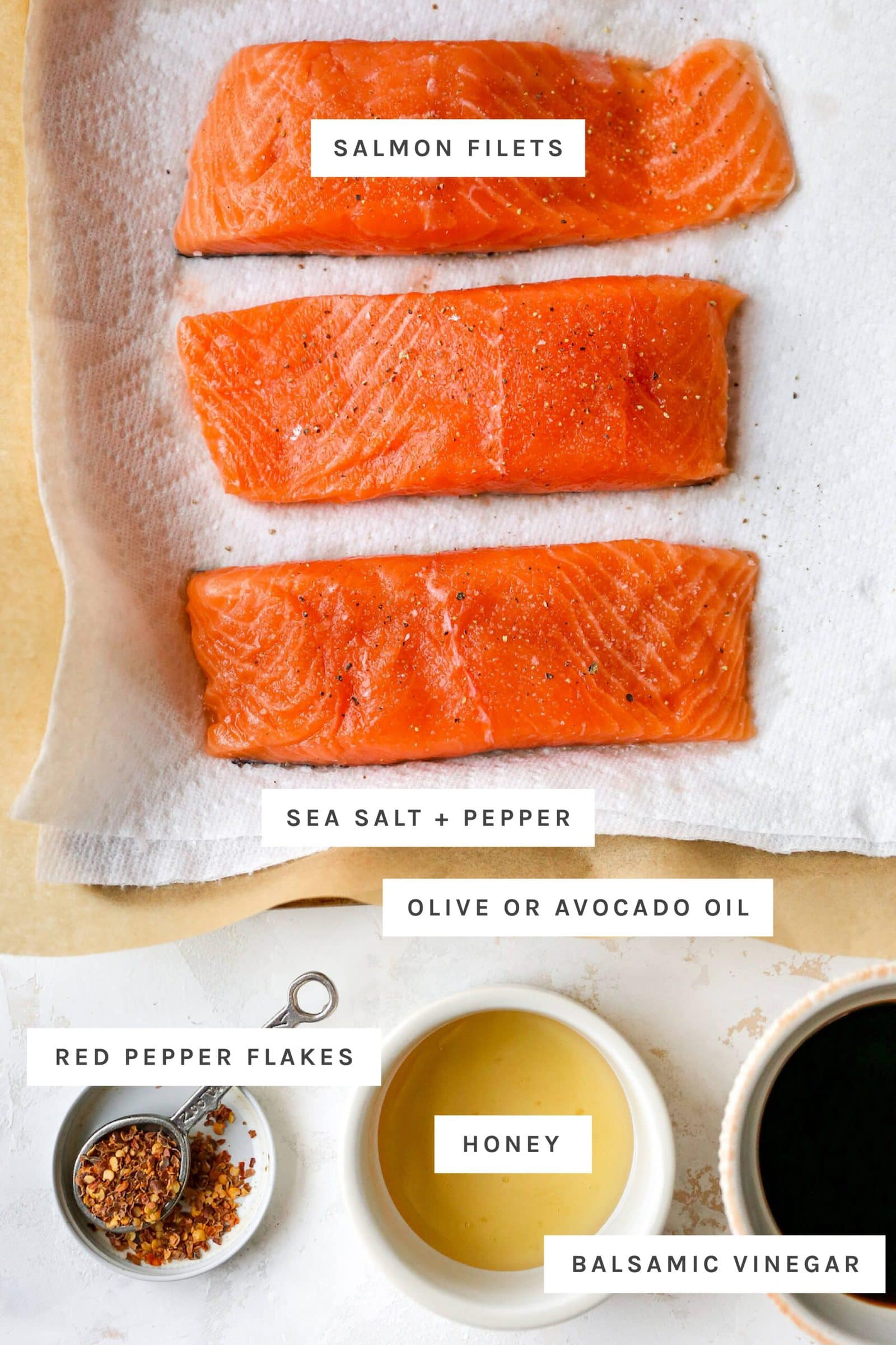 Three filets of raw salmon sprinkled with salt and pepper and bowls of red pepper, honey and balsamic vinegar.