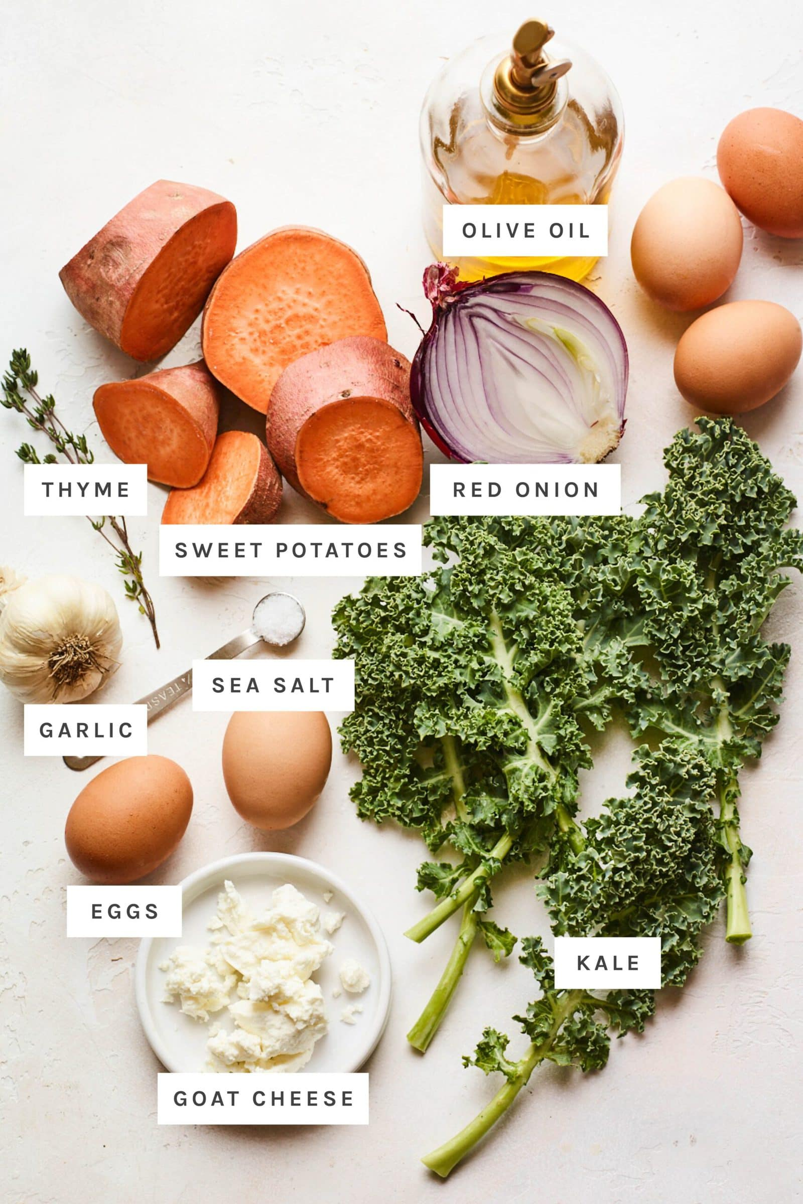 Ingredients to make a sweet potato kale frittata on a table measured out.