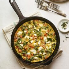 Sweet potato kale goat cheese frittata in a skillet.