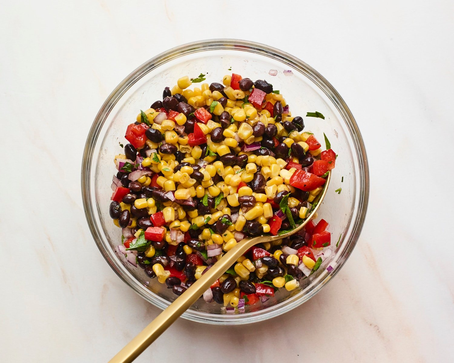 Mixing bowl with black bean and corn salad.
