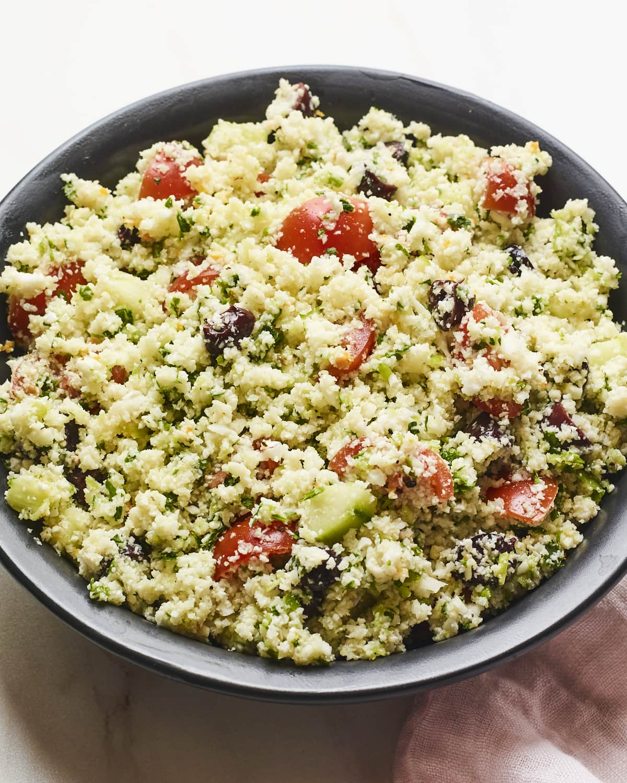 Serving bowl full of cauliflower tabbouleh.