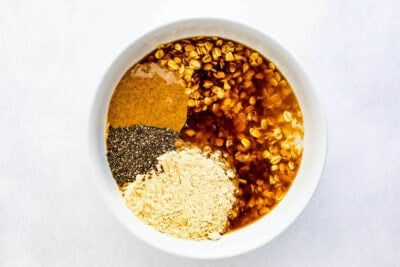 Ingredients to make coffee overnight oats in a bowl.
