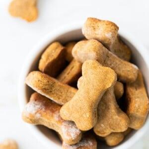 Bowl of bone-shaped homemade dog treats.