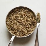 Pot with cooked quinoa.