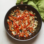 Pan with sautéed onion and bell pepper.