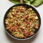 Skillet with pineapple fried quinoa.