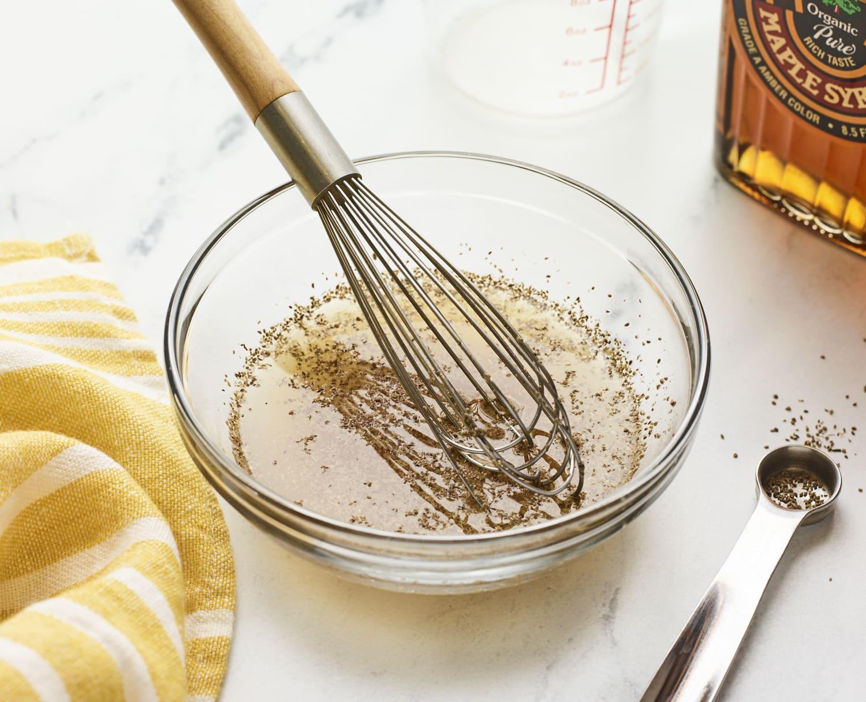 Whisk in a bowl of apple cider vinegar coleslaw.