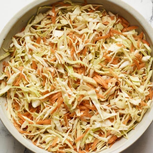 Serving bowl of apple cider vinegar coleslaw.