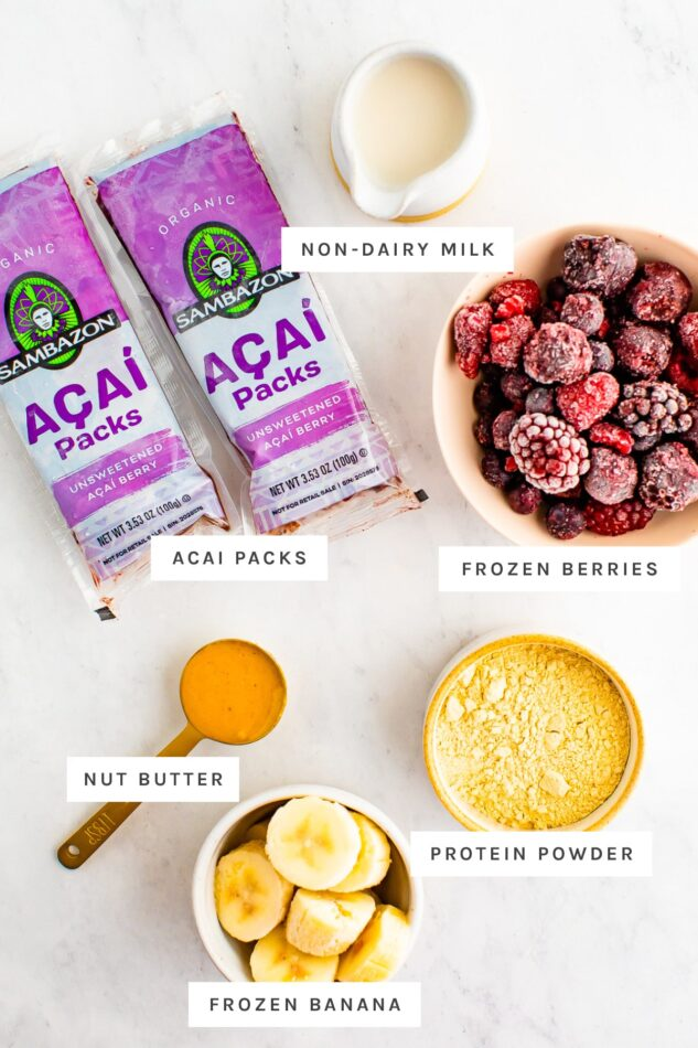 Acai packs, milk, frozen berries, peanut butter, banana and protein powder measured out to make acai bowls.