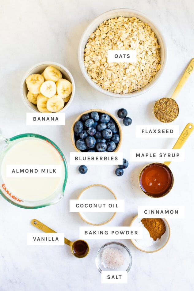 Oats, blueberries and other ingredient measured out to bake blueberry baked oatmeal.