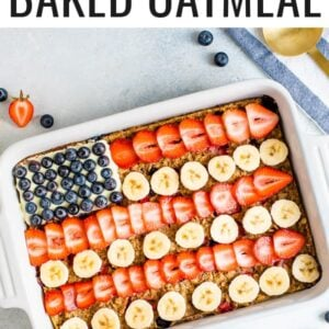 Baked oatmeal decorated to look like the American flag with blueberries, banana slices and strawberries.