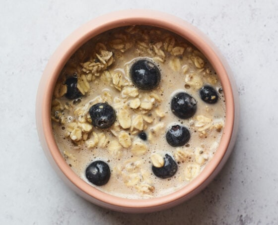 Bowl of blueberry baked oatmeal mixture before being baked.