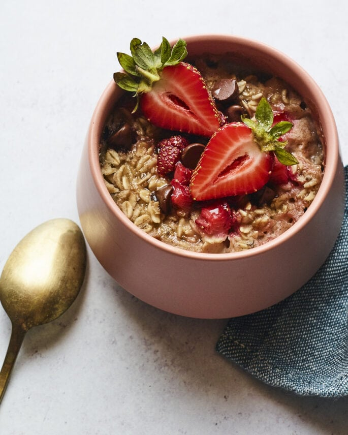 Bowl of strawberry chocolate chip baked oatmeal.