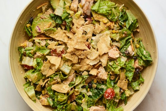 BBQ chicken salad topped with crushed tortilla chips.