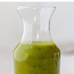 Jar of basil vinaigrette.