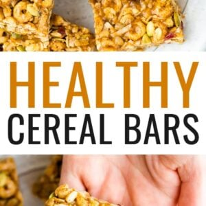 Cereal bars studded with dried cranberries and seeds on a plate. Hand holds one bar.