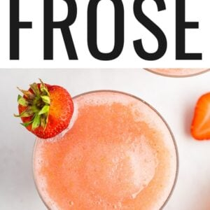 Glass of frose garnished with a strawberry.