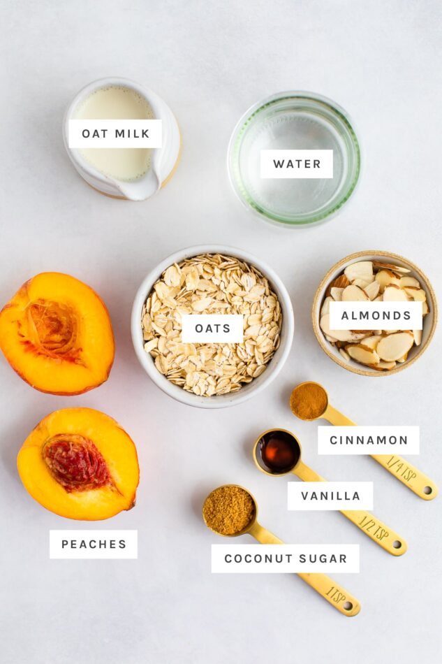 Ingredients measured out to make peaches and cream oatmeal: oat milk, water, almonds, oats, peaches, cinnamon, vanilla and coconut sugar.