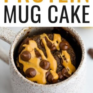 Chocolate protein mug cake drizzled with peanut butter and topped with chocolate chips.