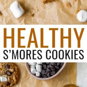 S'mores cookies on parchment paper. One has a bite taken out of it.