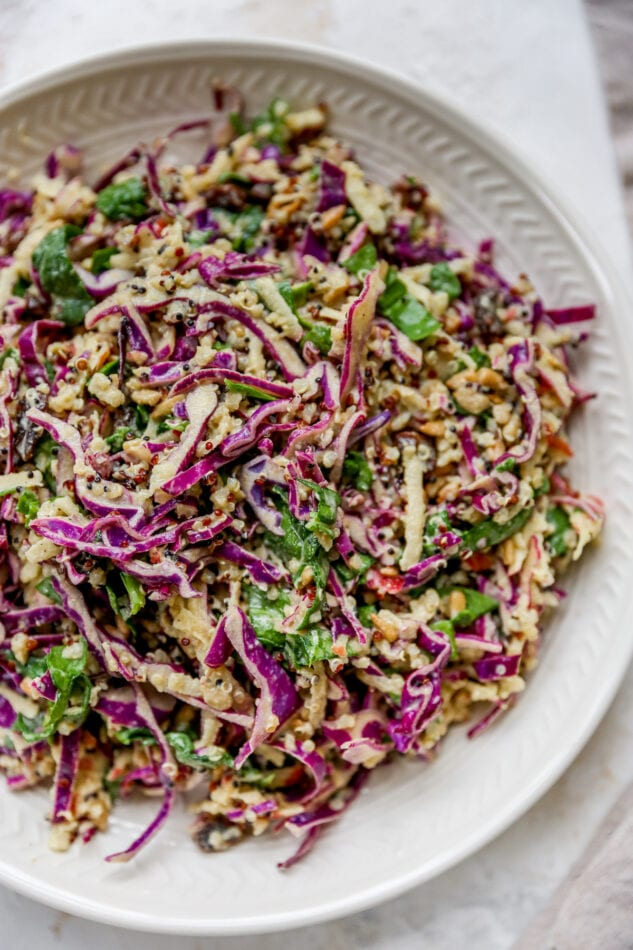 Apple slaw plated on a white plate.