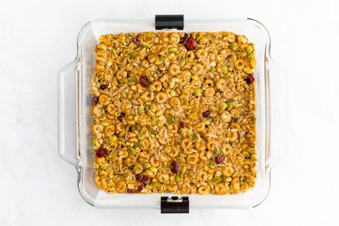Cereal bars in a square dish.