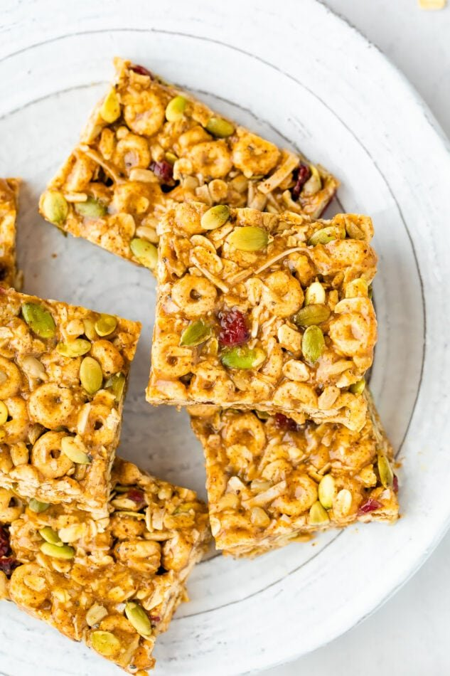 Cereal bars stacked on a plate.