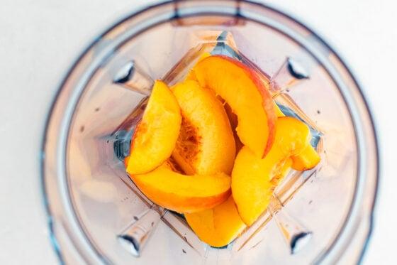 Fresh peaches in a blender, overhead shot.