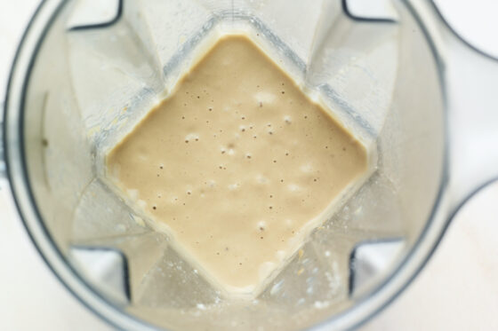 Blender with a peanut butter protein shake.