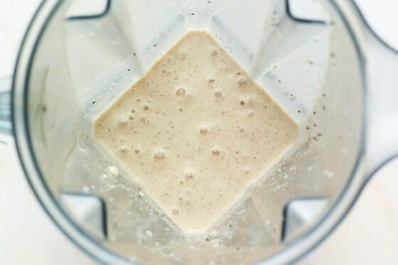 Blended vanilla protein shake in a blender.