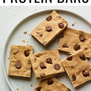 Peanut butter chocolate chip protein bars on a plate.
