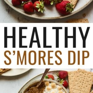 S'mores dip plated with strawberries and graham crackers for dipping. Spoon is taking a helping of the dip.