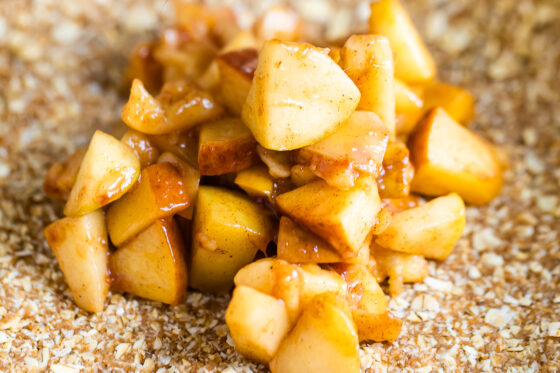A close up shot of apple filling for apple crumble bars.
