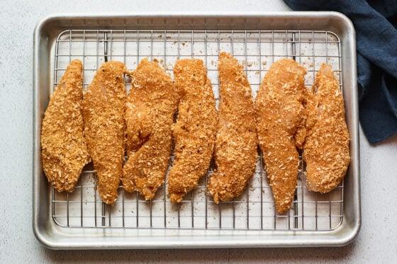 Overhead shot of chicken tenders on a baking sheet.