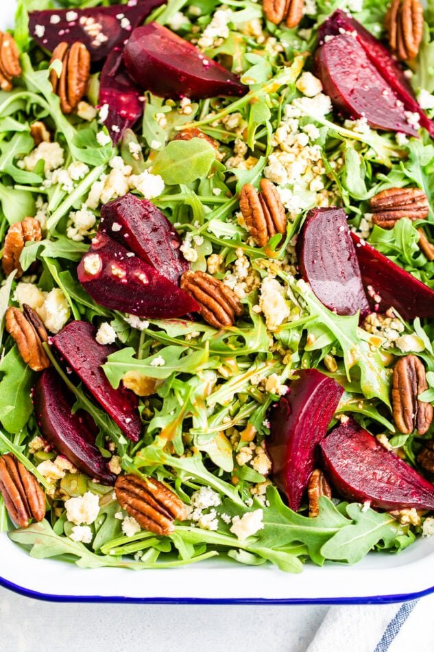 Arugula and beet salad topped with pecans and gorgonzola cheese.