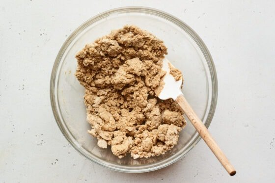Spatula in a mixing bowl with peanut butter protein bar mixture.