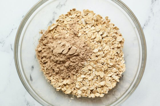 Mixing bowl with protein powder and oats.