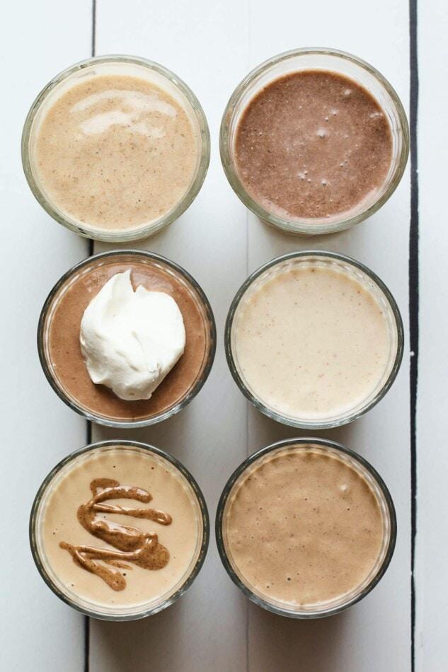 Bird's eye photo of 6 different protein shakes.