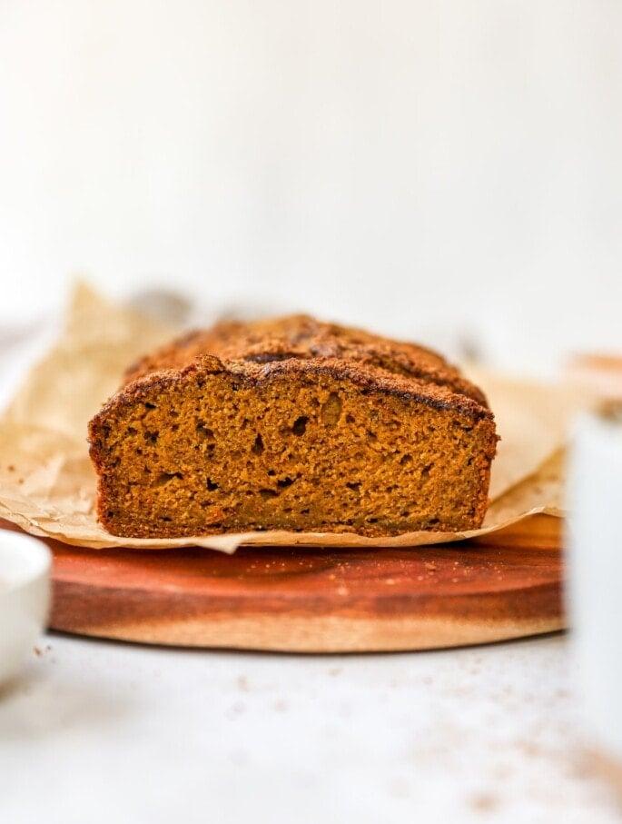 A close up shot of a slice of pumpkin bread.