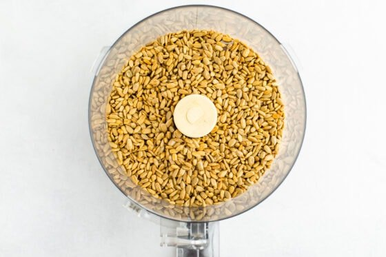 Overhead shot of sunflower seeds in a food processor.