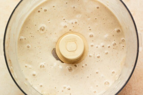 Blended base in a food processor for the vanilla protein ice cream.