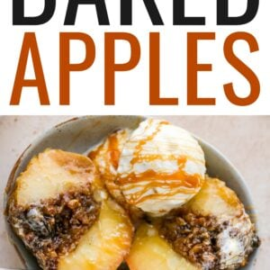 An overhead shot of a baked apple sliced in half with a scoop of ice cream and a caramel drizzle in a shallow bowl with a silver spoon.