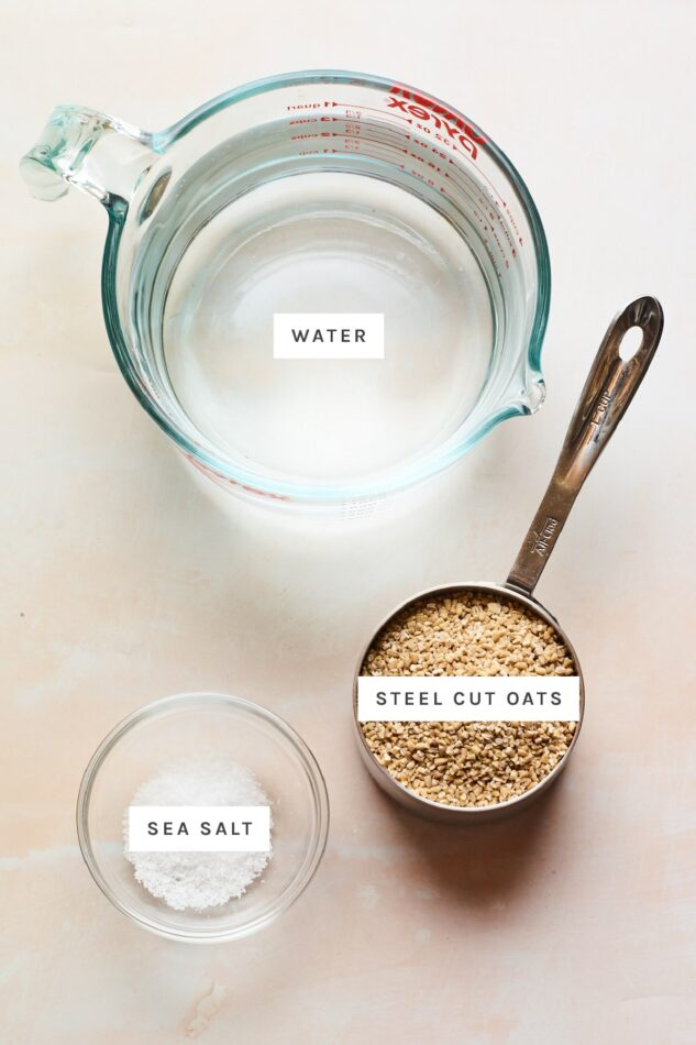 Ingredients measured out to make steel cut oats: water, steel cut oats and sea salt.