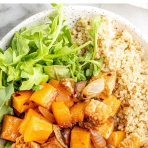 Overhead view of butternut squash tempeh bake served with quinoa and greens.