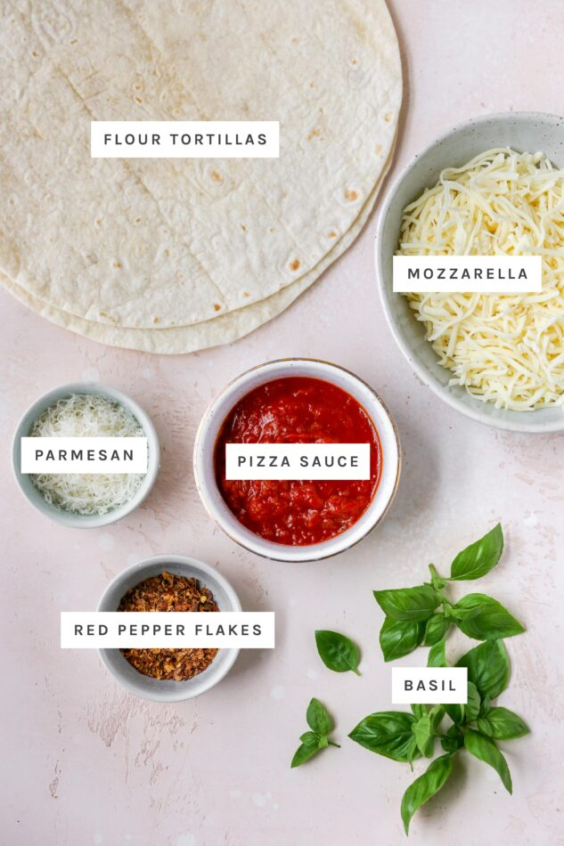 Ingredients measured out to make tortilla pizza: flour tortillas, mozzarella, parmesan, pizza sauce, red pepper flakes and basil.