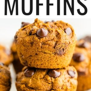 Two chocolate chip pumpkin muffins stacked on top of each other.